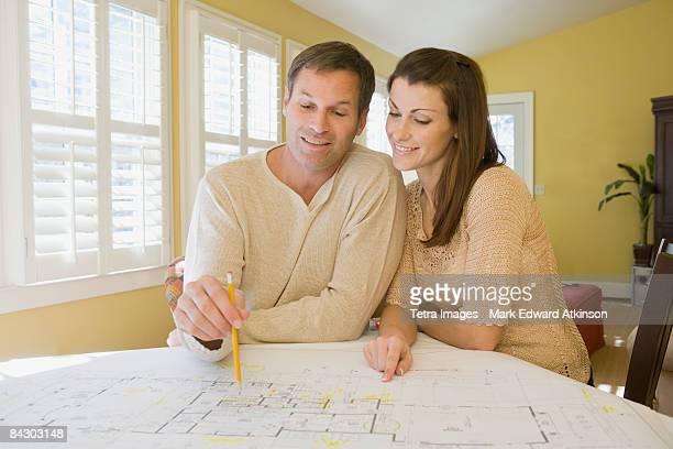 Couple reviewing house blueprints