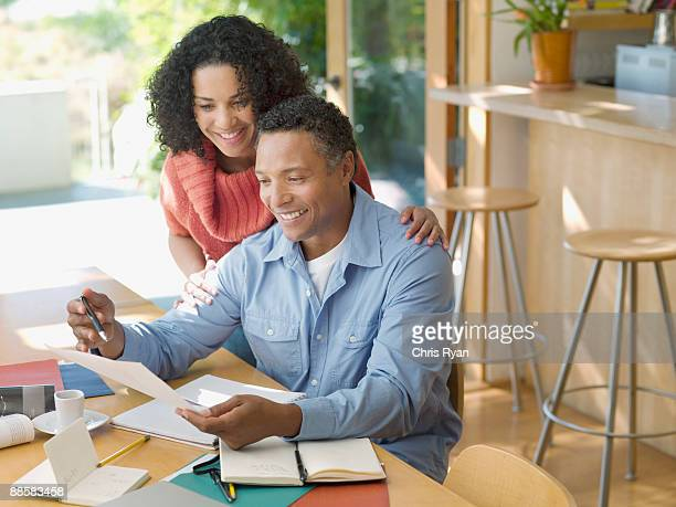 Couple reviewing paperwork at home