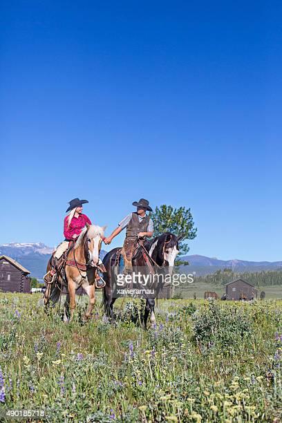 Couple riding a horse in Montana