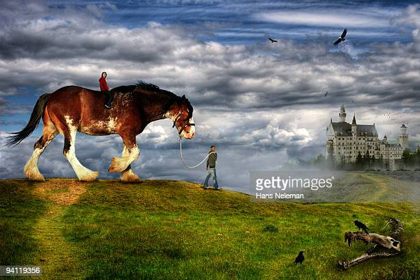 Couple riding a horse with a castle in the background, Republic of Ireland