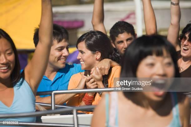 Couple riding a roller coaster