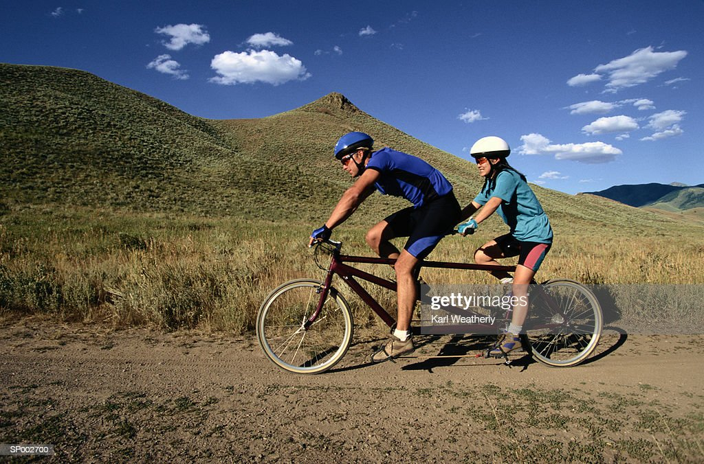 Couple Riding a Tandem Bicycle : Stock Photo