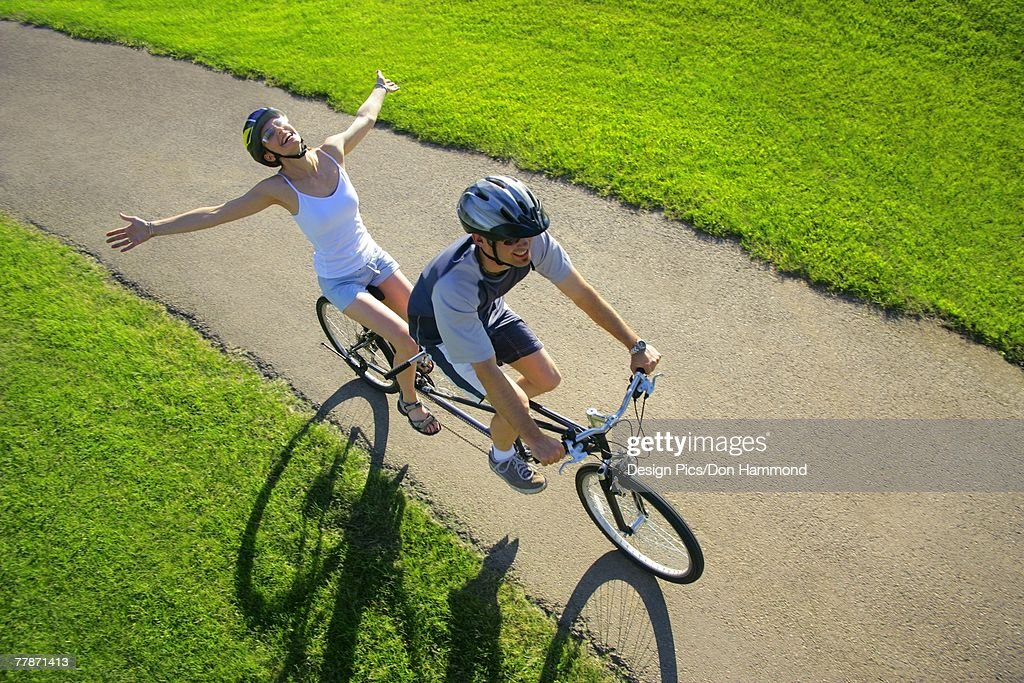 Couple riding a tandem