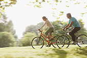 Couple riding bicycles together
