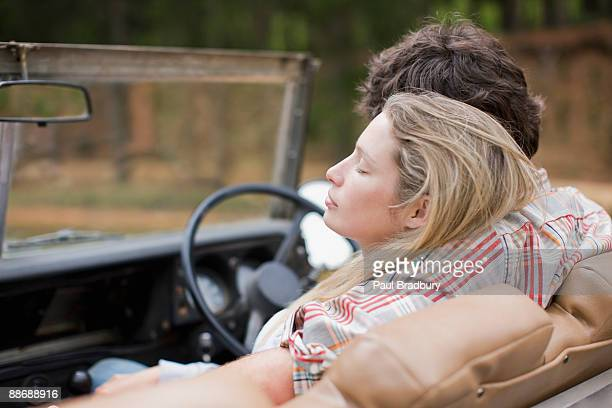 Couple riding in jeep