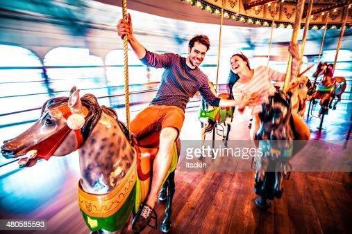 Couple riding merry-go-round in LA