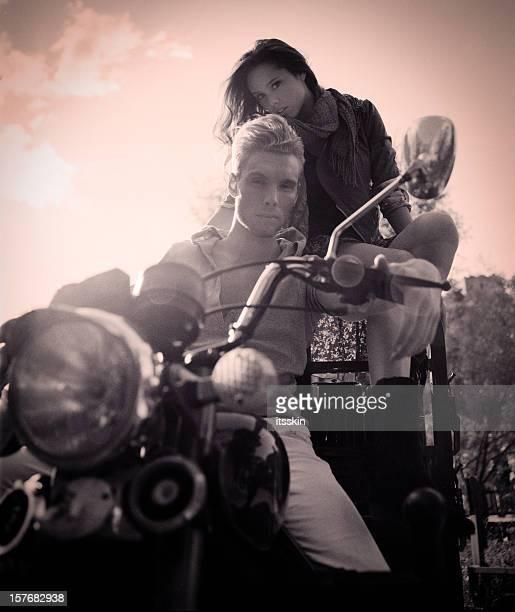 Couple riding motorbike