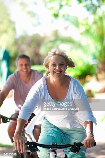 Couple riding mountain bikes together