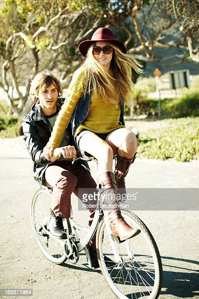 A couple riding on a bike.