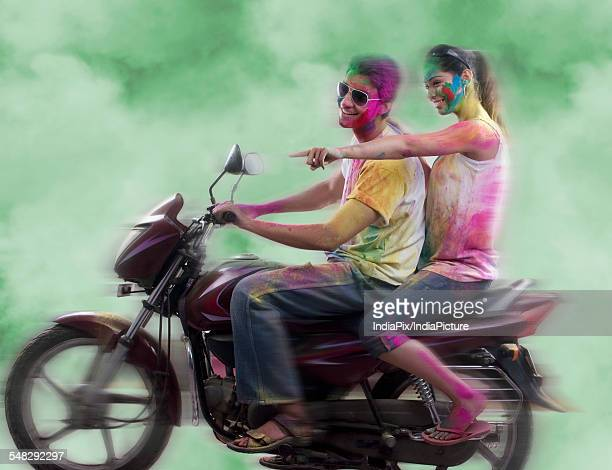 Couple riding on a motorcycle