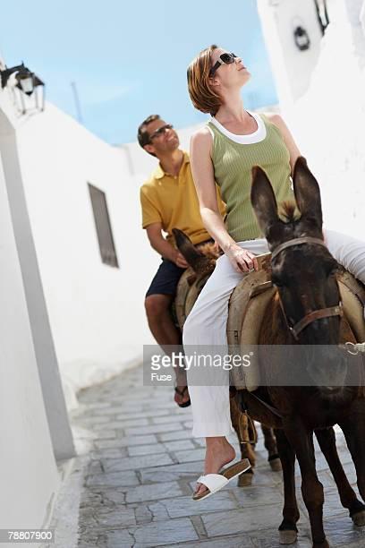 Couple Riding on Donkeys