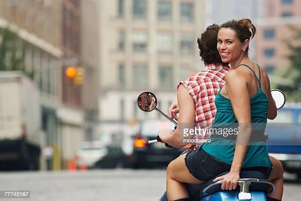 Couple Riding on Scooter Together