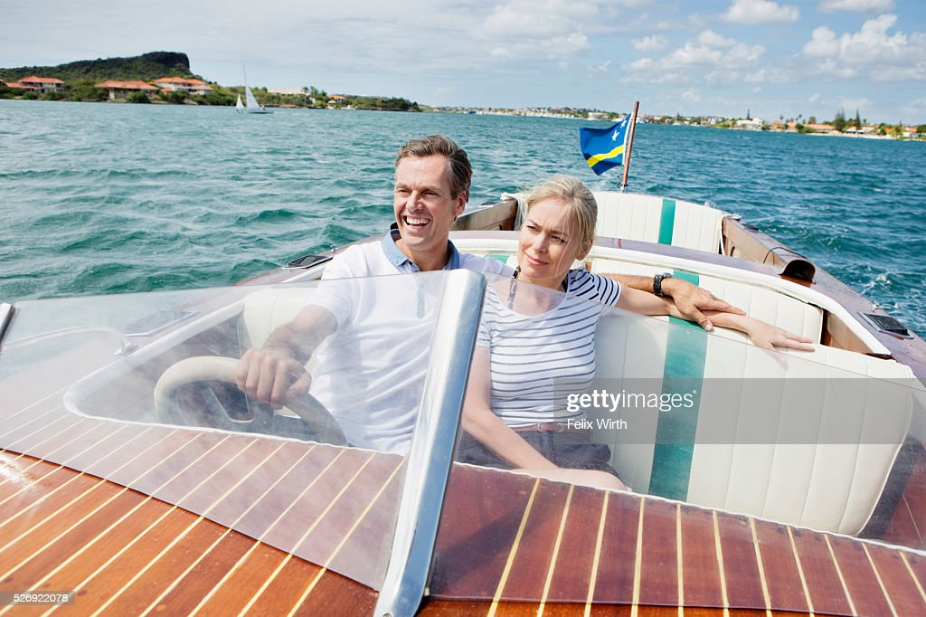 Couple riding speedboat : Bildbanksbilder
