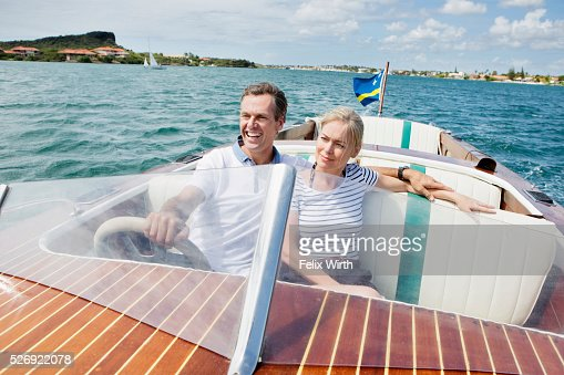 Couple riding speedboat : Stock Photo