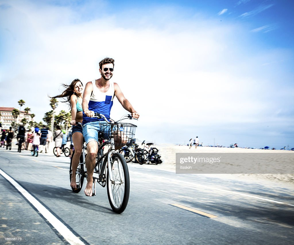 Couple riding tandem bicycle in LA