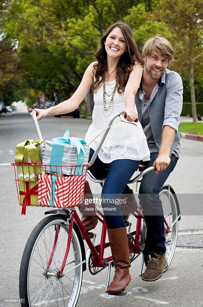stock photo close loving couple riding bike city