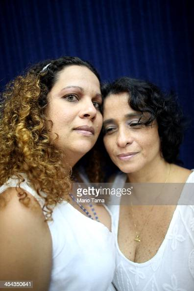 Couple Roberta Felitte and Karina Soares together five years pose before marrying at what was billed as the world's largest communal gay wedding on...