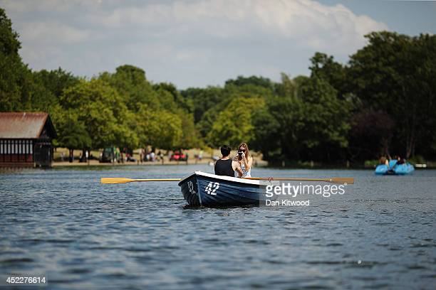 A couple row a boat across the Serpentine in Hyde Park on July 17 2014 in London England The Met Office has issued a heatwave alert as temperatures...