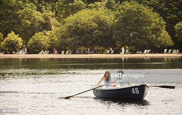 A couple row a boat in the sun on the Serpentine Lake in Hyde Park on June 29 2009 in London England The Met Office has announced a weather warning...