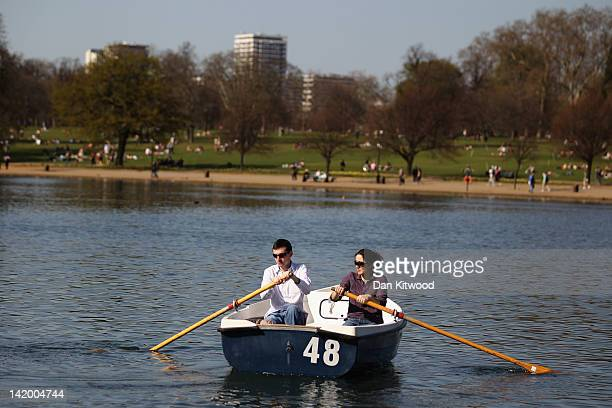 A couple row a boat on the Serpentine in Hyde Park on March 28 2012 in London United Kingdom The UK is currently experiencing a period of warm...