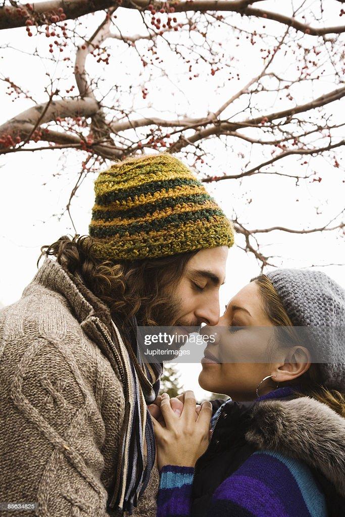 Couple rubbing noses
