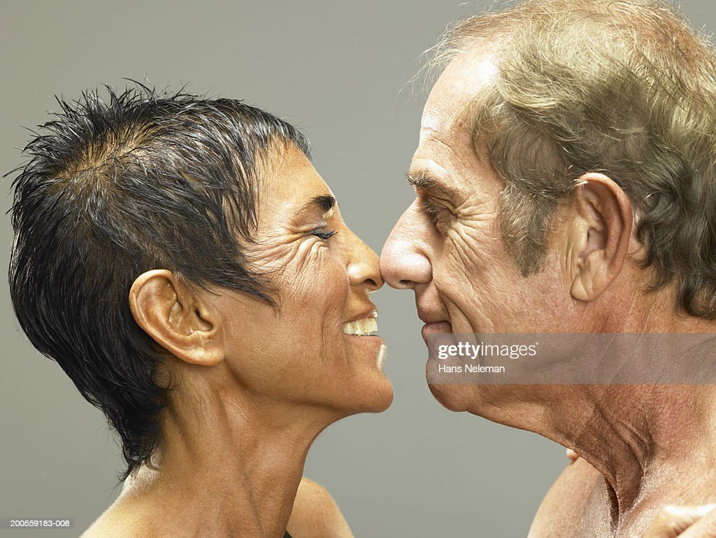 Couple rubbing noses, smiling, close-up : Stock Photo