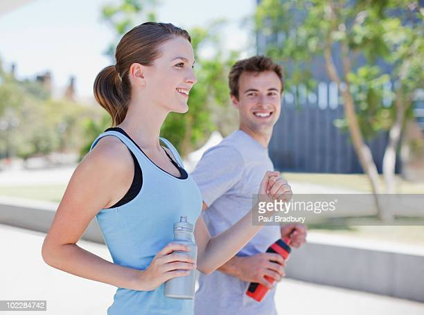 Couple running in urban environment