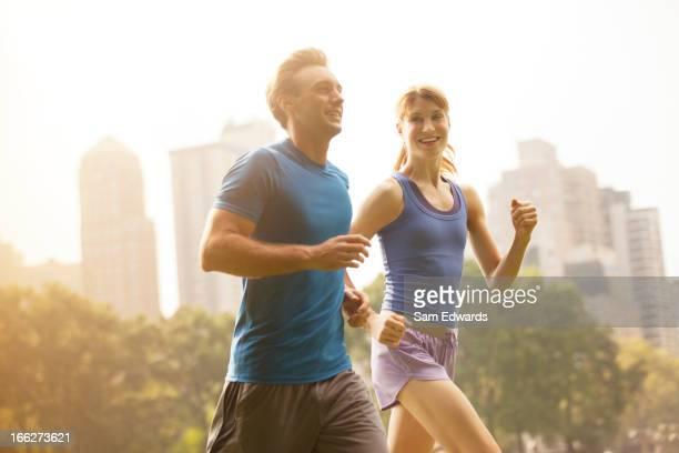 Couple running in urban park