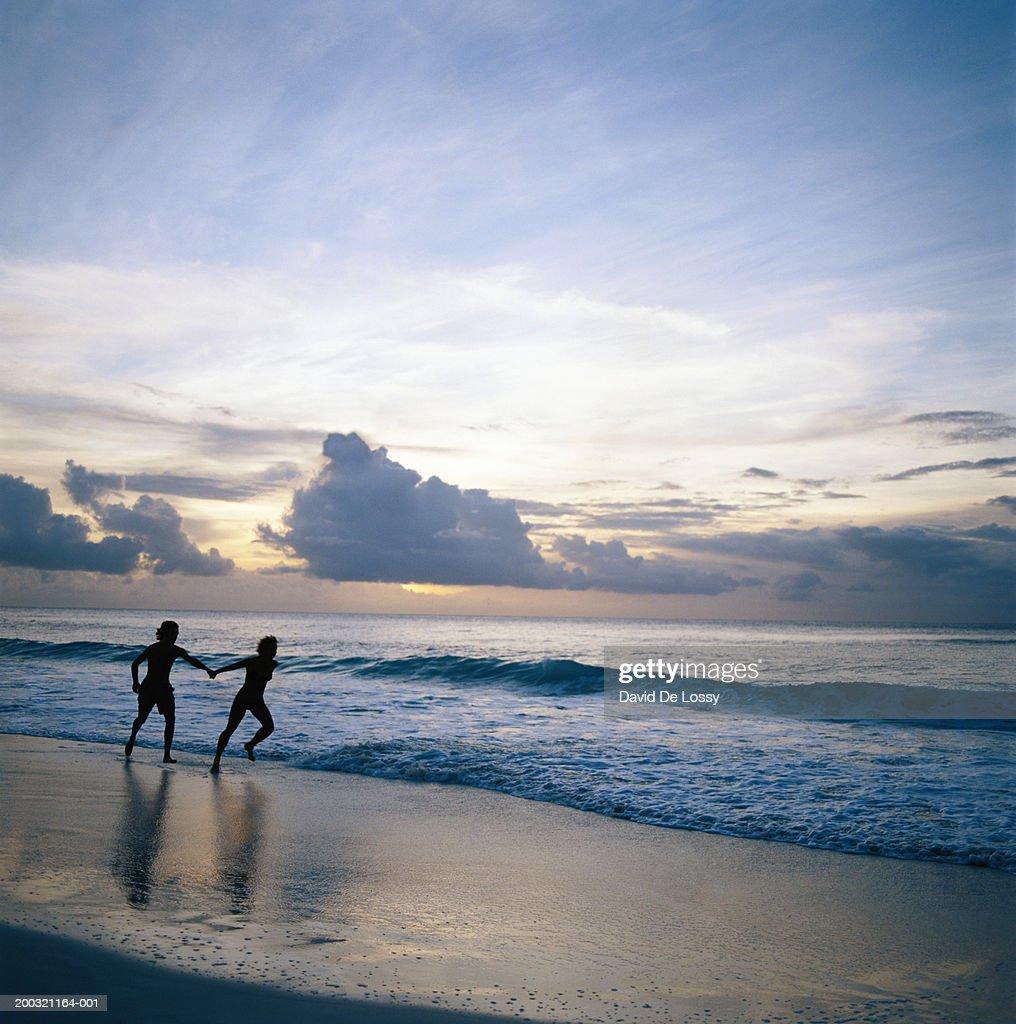 Couple running beach