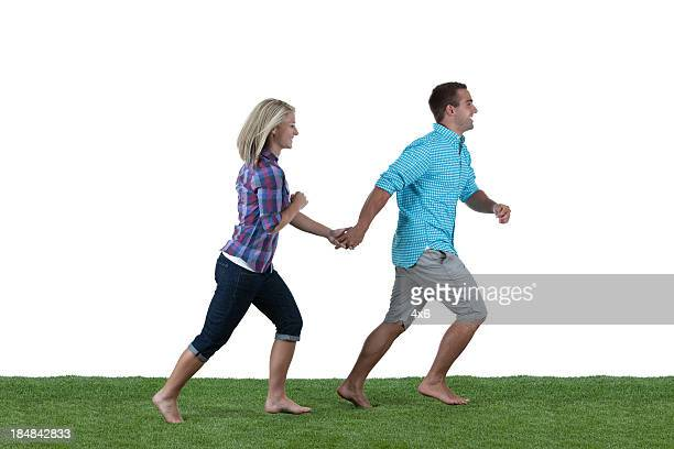 Couple running on the grass