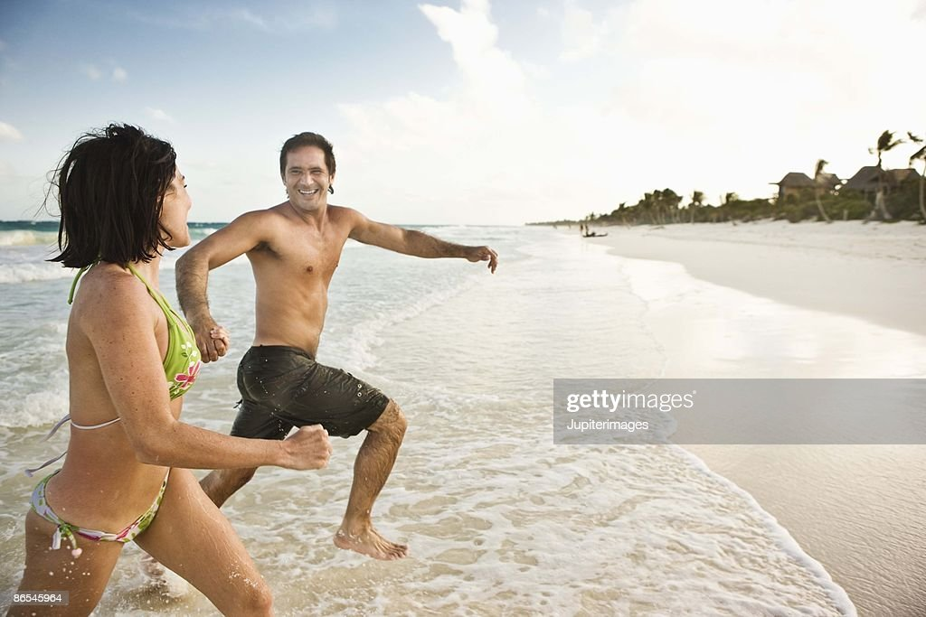 Couple running on the shore