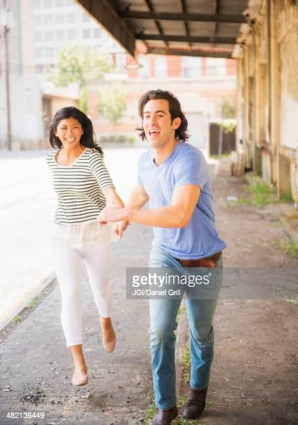 Couple running on urban street