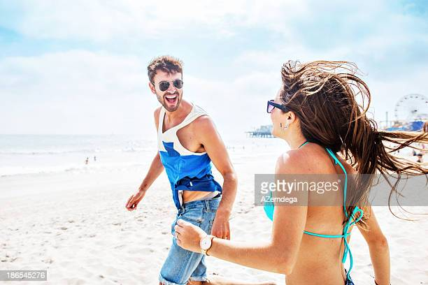 Couple running to the sea