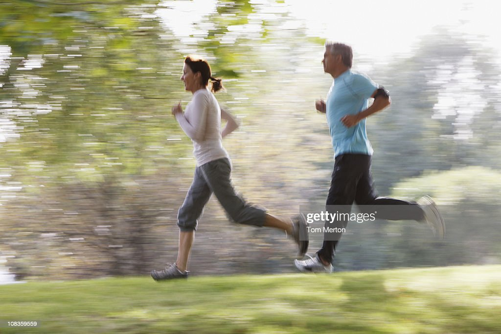 Couple running together : Stock Photo