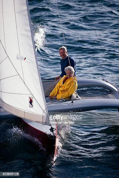Couple Sailing a Trimaran Along Narragansett Bay