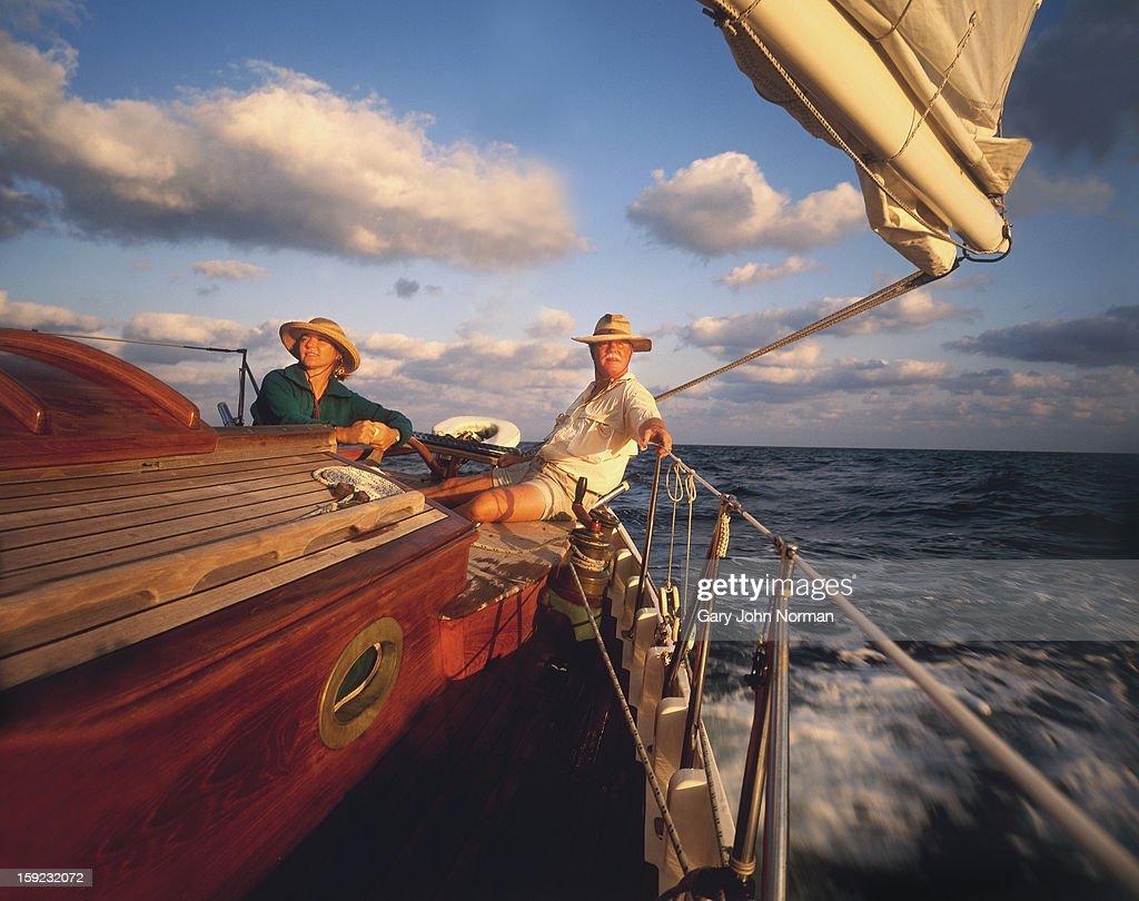 Couple sailing classic yacht : Stock Photo