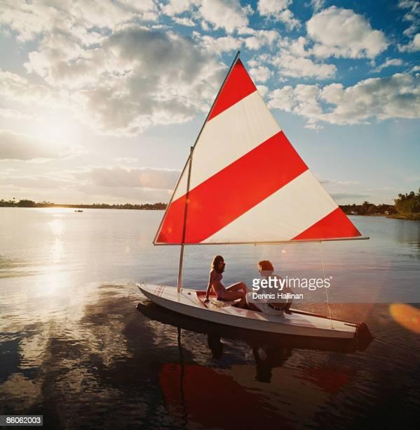 Couple sailing in lake