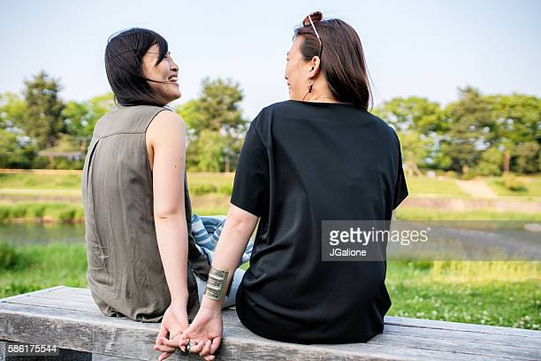 LGBT couple sat lovingly together