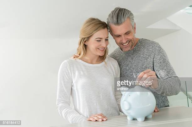 Couple saving money in a piggybank
