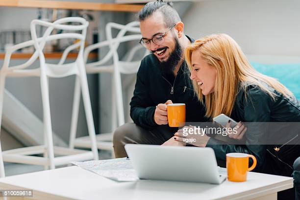 Couple searching for accommodation online.