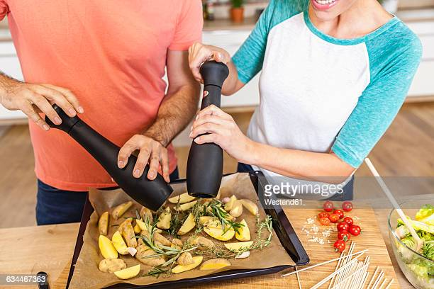 Couple seasoning potato wedges