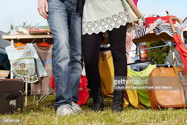 Couple selling items at yard sale