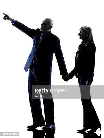 couple senior pointing silhouette : Stock Photo