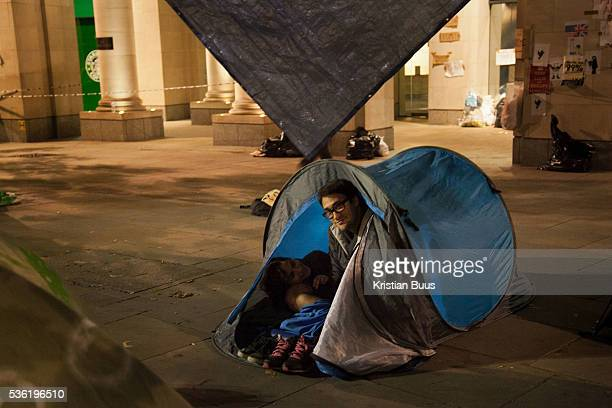 A couple settling in for the night The London Stock Exchange was attempted occypied in solidarity with Occupy Wall in Street in New York and in...