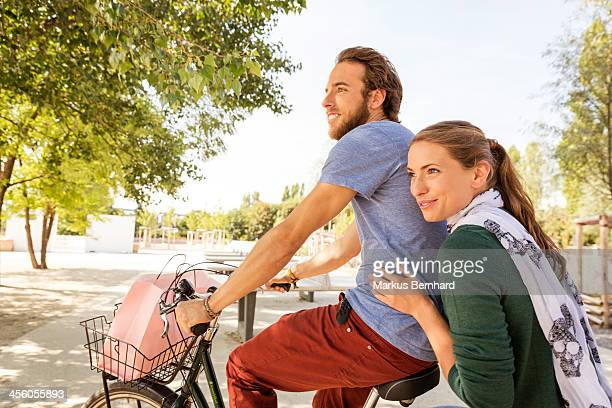 Couple share a ride on bicycle