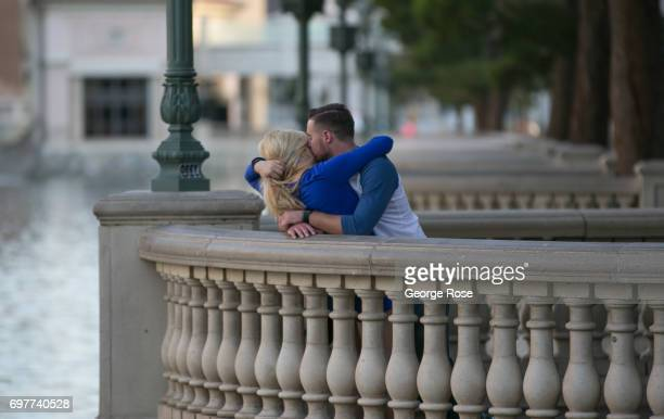 A couple shares a private moment near the lake at the Bellagio Hotel Casino on May 31 2017 in Las Vegas Nevada Tourism in America's 'Sin City' has...