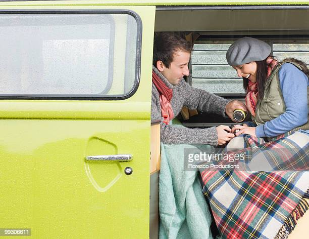 Couple sharing a hot drink together