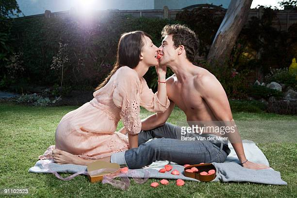 couple sharing a sweet.