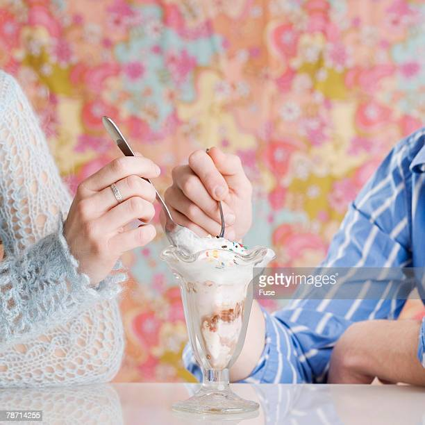 Couple Sharing an Ice Cream Sundae