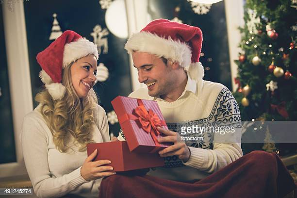 Couple sharing Christmas presents at home
